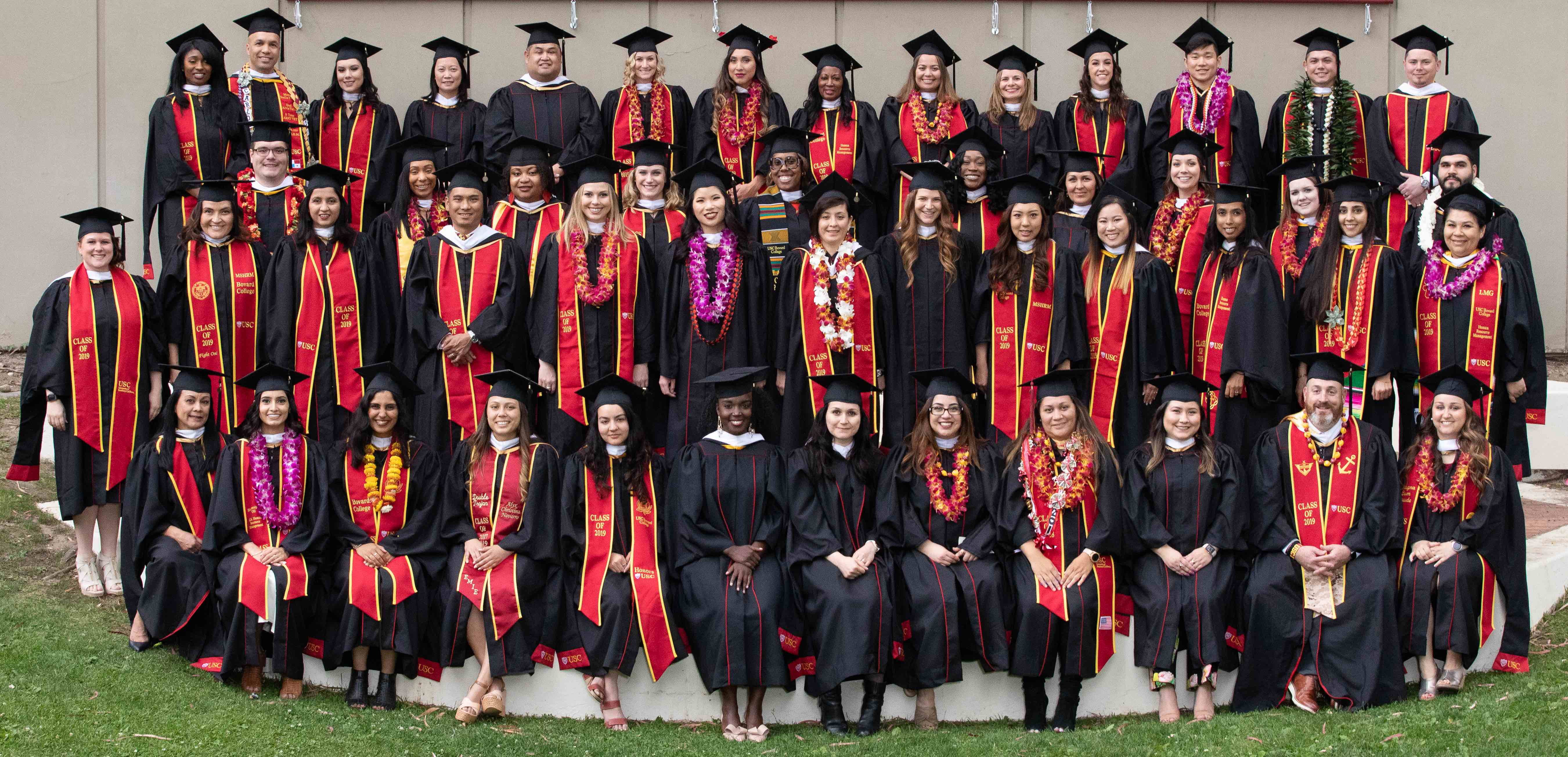 Group photo of USC Bovard College MS in Human Resource Management graduates at commencement
